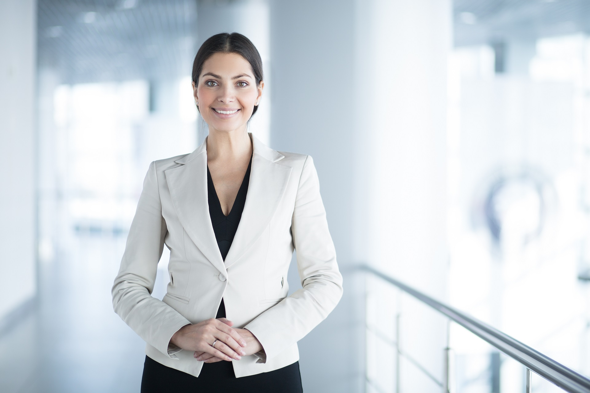Happy Elegant Business Woman in Office Hall